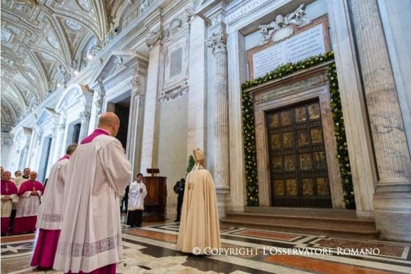 Pope Francis before the Holy Door of St. Peter's Basilica during the convocation of the Jubilee of Mercy, April 11, 2015.