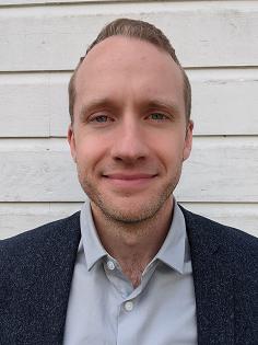 Headshot of Dr. Thomas Metcalf.
